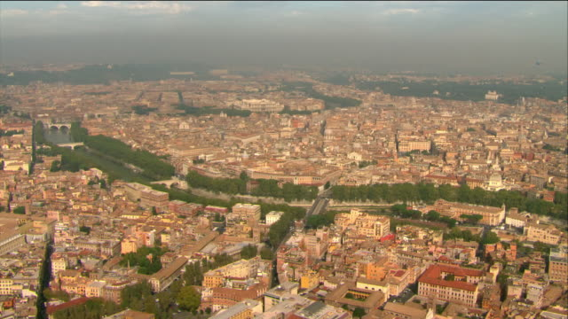 Aerial over city of Rome to Colosseum / Italy