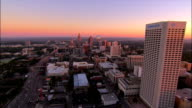 Aerial over cityscape and traffic on motorway at sunrise/ Atlanta, Georgia