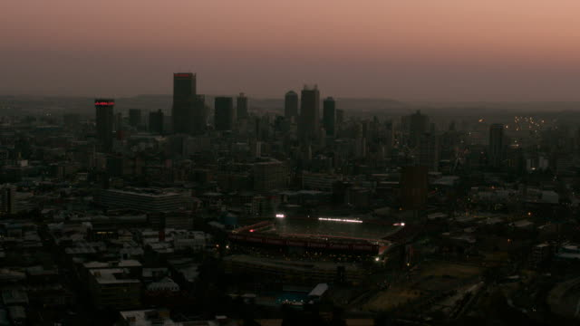 Aerial over Ellis Park Stadium and Johannesburg cityscape