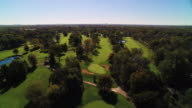 Aerial over golf course outside of Chicago with skyline in the distance