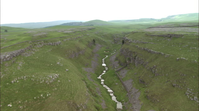 Aerial over Goredale Scar ravine, Yorkshire Dales, UK