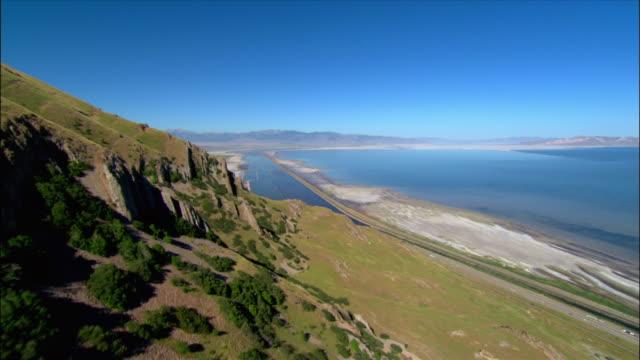 Aerial over South shore of Great Salt Lake / Interstate 80 below / Utah