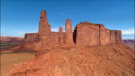 Aerial over 'Three Sisters' rock formation / Monument Valley