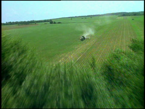 Aerial over tractor plowing field