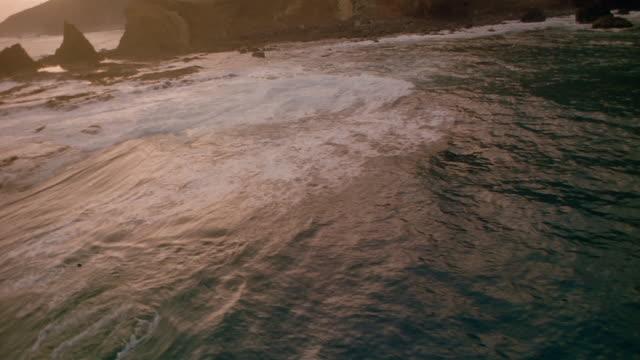 Aerial over waves crashing on rocks off the coast of the Atlantic Ocean / Spain
