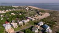 Aerial overhead Tybee Island beach and houses/ lighthouse and compound/ Georgia