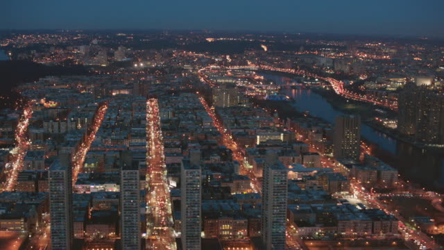 Aerial pan over Harlem at night with view of the Bronx, NYC