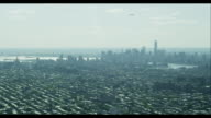 Aerial Pan Right Downtown Manhattan Skyline with Airplane
