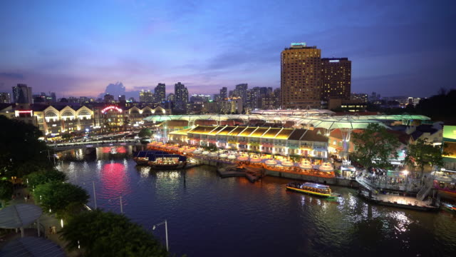 Aerial panning shot: People crowd at Clark Quay Sunset