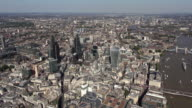 Aerial panorama of City of London with iconic skyscrapers including Walkie-Talkie, The Gherkin and the Cheesegrater, Heron Tower, Tower 42 and The Barbican, with Tower Bridge and the River Thames winding down through east London to Canary Wharf