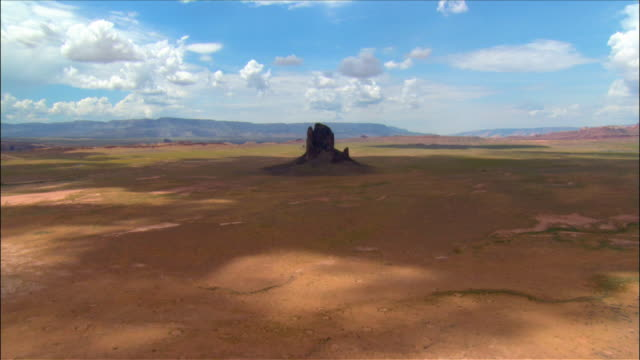 Aerial past 'Chaistla Butte' rock formation / Monument Valley