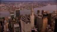 Aerial past MetLife Building toward Empire State Building/ New York City