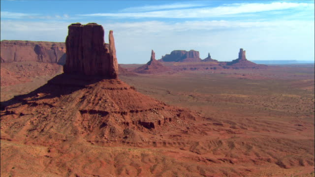 Aerial past the 'West Mitten' rock formation / Monument Valley