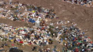 Aerial piles of debris and trash outside the Louisiana Superdome / zoom out roof / New Orleans Louisiana