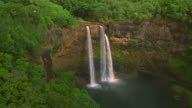 Aerial point of view approaching and passing over Wailua Falls / Kauai, Hawaii