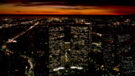 Aerial point of view over Century Tower Plaza in Century City at night / Los Angeles