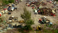 Aerial point of view over junkyard with car scraps / Miami, Florida