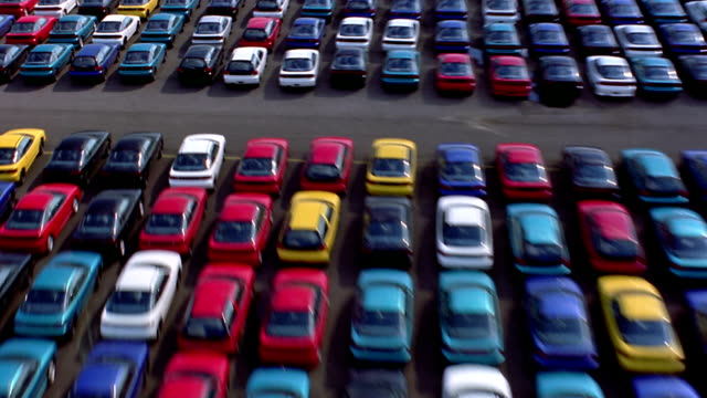 Aerial point of view over new cars in lot of car factory / Baltimore, Maryland