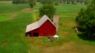 Aerial point of view over red barn with silo / Indiana