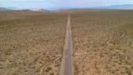 Aerial point of view over road in desert