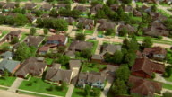 Aerial point of view over suburban houses and streets / Houston, Texas