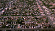 Aerial point of view tilt up over suburban Southern Los Angeles / California