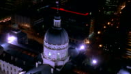 Aerial point of view zoom in over State Capital Building and downtown Indianapolis at night / Indiana