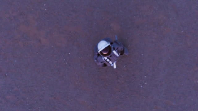 Aerial portrait zoom in of astronaut in space suit
