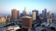 Aerial push into downtown Los Angeles California at sunset