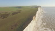 Aerial reveal of Belle Tout lighthouse and Beachy Head