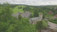 Aerial reveal of West Dean House and Church