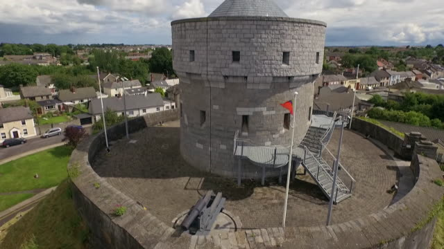 Aerial sequence showing Drogheda's Millmount martello tower and St. Peter's Catholic church, Republic of Ireland.