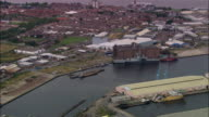 Aerial ship moored at Birkenhead Docks with traffic and cityscape/ Birkenhead, England