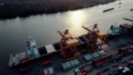 Aerial shipping port cargo at sunset