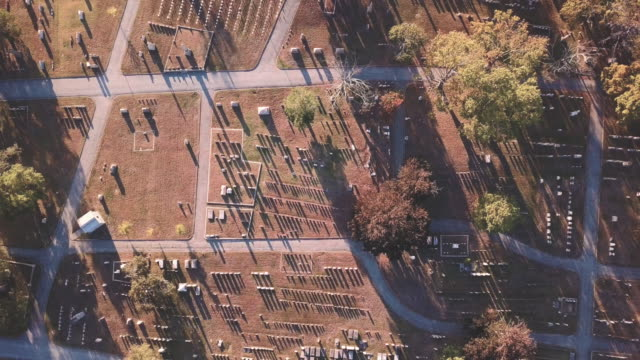 Aerial shot above a cemetery on a warm summer afternoon.