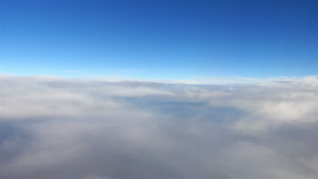 Aerial shot above the clouds in 4K