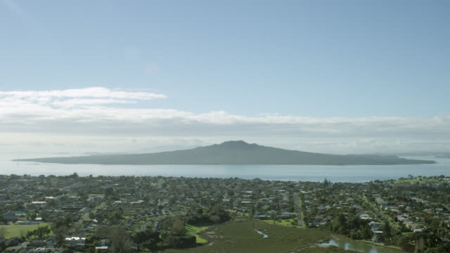 Aerial shot across Auckland's north shore towards Rangitoto Island