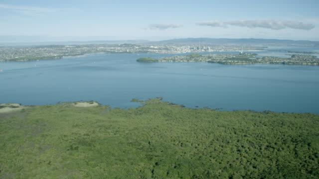 Aerial shot across Waitemata Harbour towards Auckland City