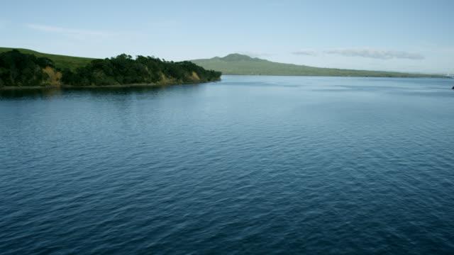 Aerial shot across water towards Rangitoto Island.