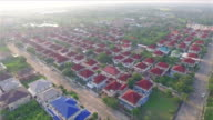 Aerial Shot Community in the mist in Thailand