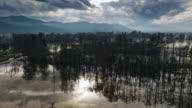 Aerial shot crossing the flooded marsh