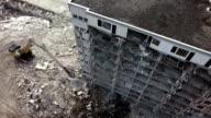 Aerial shot demolition crane dismantling a building