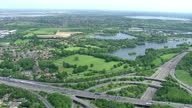 Aerial shot flying over motorway lakes approaching London on May 25 2015 in London England