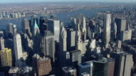 Aerial shot looking over the skyscrapers of Lower Manhattan toward the Hudson River in New York City.