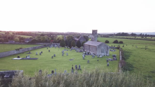 Aerial shot of a cemetery in the countryside of Ireland.