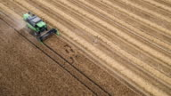 Aerial Shot Of A Combine Harvester Cutting Wheat