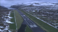 Aerial shot of a plane coming into land at Vagar Airport on the Faroe Islands.