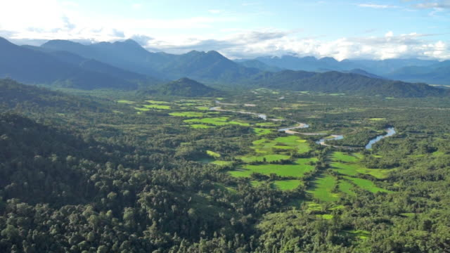 Aerial shot of a river and green mountains near Putao, Myanmar