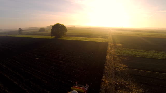 HD: Aerial Shot Of A Tractor In The Field