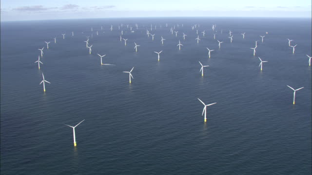 Aerial shot of a wind farm off the coast of Denmark.